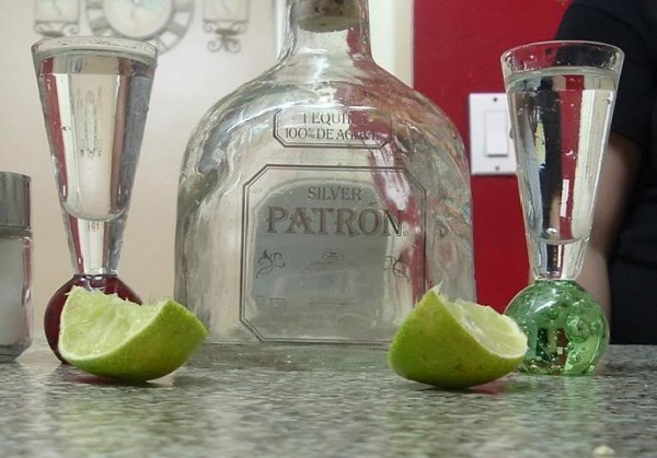 Patron tequila plus two limes